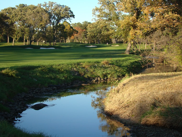 The best holes at Olympia Fields feature either topography or the creek. The very best holes feature such as here. The bunker in the hillside is thirty yards short of the green and is another fine example of the club restoring a Park bunker that is 1) well off the putting surface and 2) directly in the line of play.