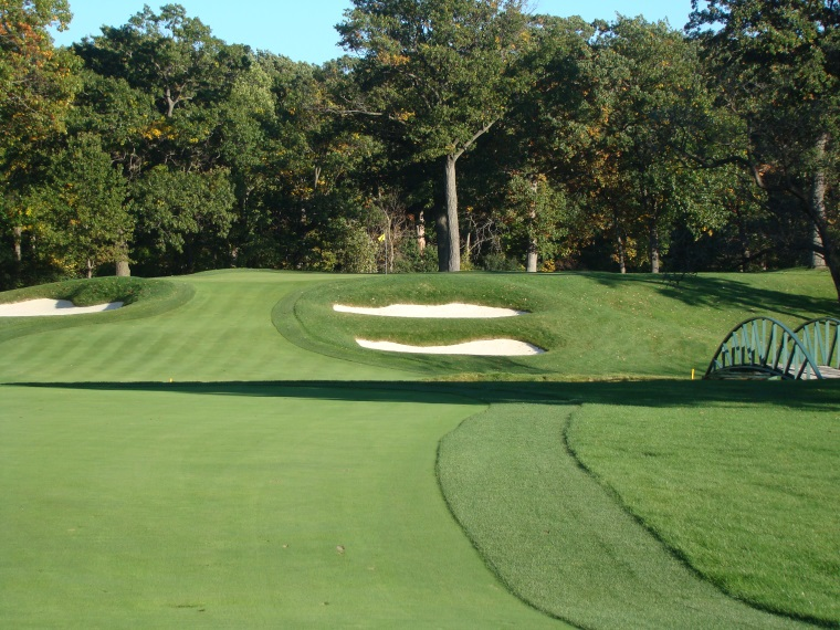 Ideally, the approach to the elevated green is played from a level lie in the fairway.