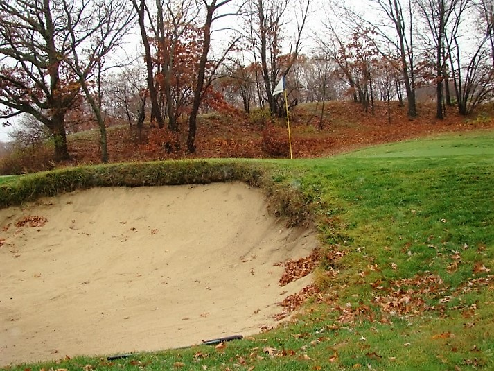 The deep sand faced greenside bunkers are made easier by ... the sand wedge!