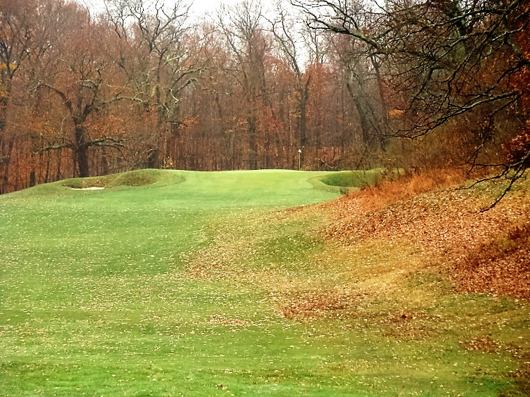 The third meanders up its own valley to a green punctuated left and right by deep bunkers.