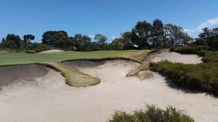 Approach shots that fail to reach the putting surface are often shunted right into this famous bunker.