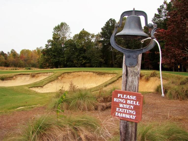 A bell on a golf course signifies the architect's embrace of rambunctious landforms.