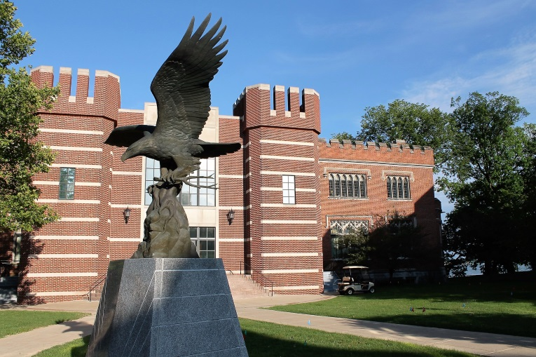 No half measures on the campus of Culver. In the background is the Culver Legion Memorial building for those alumni that gave their life in World War I and in the foreground is the Centennial Eagle given by a Texas alumnus in 1994. How could such a place countenance a diminished golf course? Answer: It couldn't.