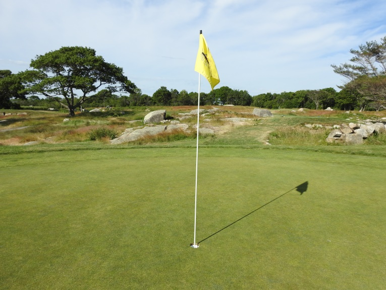 The green on the par 5 8th hole is set among rocks and sits on a knob that rejects all but the best played shots.