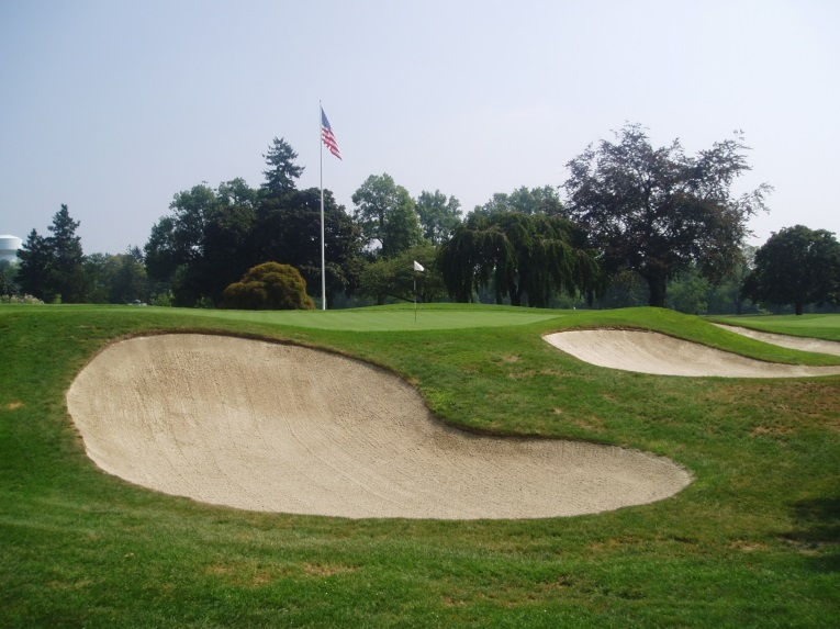 An example of a Winged Foot bunker pre restoration with a clean lip and smooth curvature