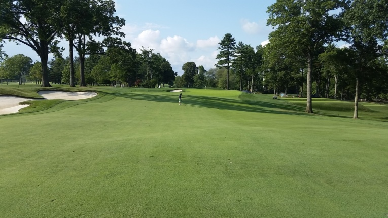 For the amateur, the ideal third shot will come from the flat here before the fairway cants severely on approach to the green. While subtle, Gil Hanse's fairway expansion on the left brought the fairway bunker and greenside bunker back in play for any player who tries to run the ball up the left side onto the green in two.
