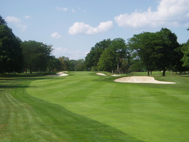 The lone fairway bunker and close greenside bunkers on the 11th are its primary defense given its length, but notice how there is several feet of rough between the bunkers and the fairway and the green pre-restoration. Additionally the rough has pinched in the approach area to the green, leaving only a 10 yard wide window of fairway to run a ball up.