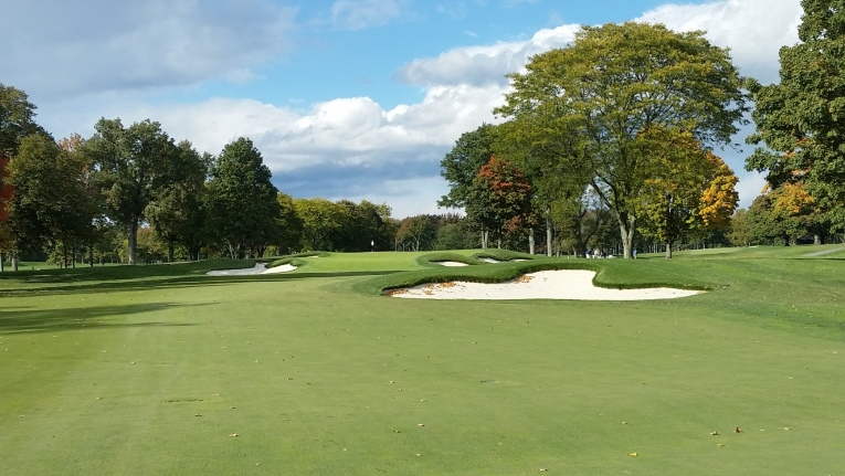 Now, post renovation, the fairway runs up the right side straight into the bunker on line with the green and the approach has been considerably expanded, allowing the ball to roll up onto and potentially off of the green into the greenside bunkers.