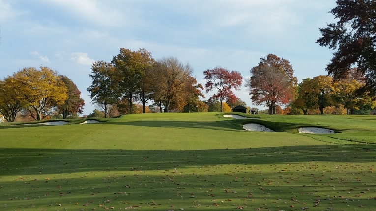 The sixteenth green is the highest point of the property, leaving the long approach shot fully exposed to the elements. Expansion of the fairway and approach has brought all the bunkers back into play.
