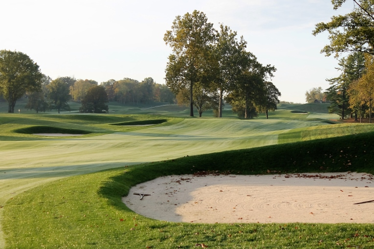 The journey up the slight grade begins by scooting past this bunker with one's tee ball.