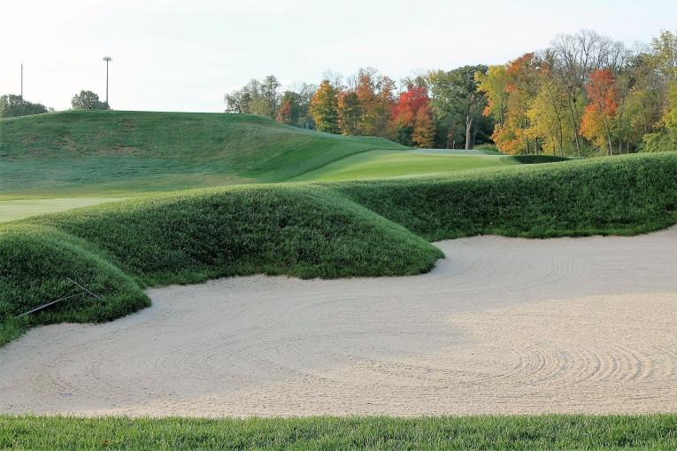 Assuming one avoids this steep lipped bunker right of the fairway, then perhaps by some divine miracle ...