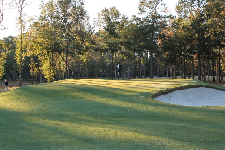 The 1st green complex is fraught with challenge with its tiny putting surface and fall-offs on all sides.