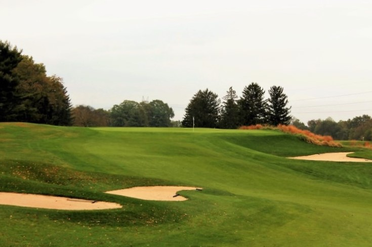 ... the fairway twists and weaves to a plateau green that was benched into the hillside.
