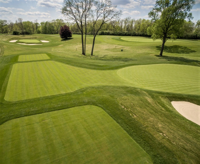 Moraine is a walker's paradise with numerous short green to tee walks. One of the most seamless occurs after holing out at the fourth, seen right.
