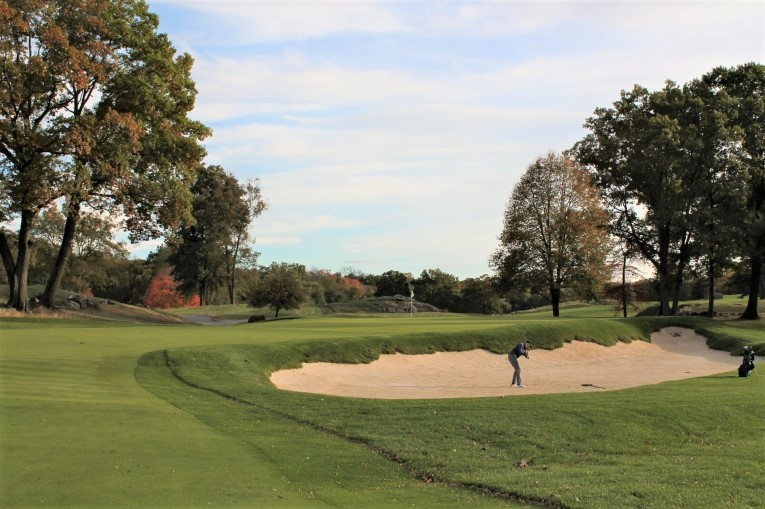 The largest greenside bunker on the course dominates the green's right side and places emphasis on finding the left center of the fairway off the tee.